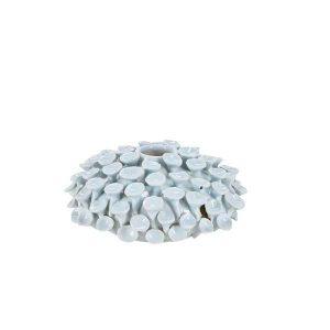 Vasen er rund og lille med motiv formet som kammuslinger.En super unik og sjov vase